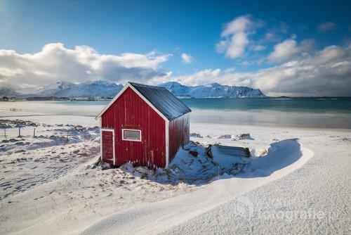 A Red Rorbuer cabin in Lofoten Islands in Winter time