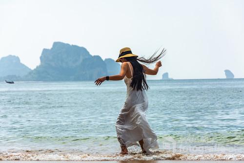 Young woman on a beach, Ao Nang, Krabi, Thailand