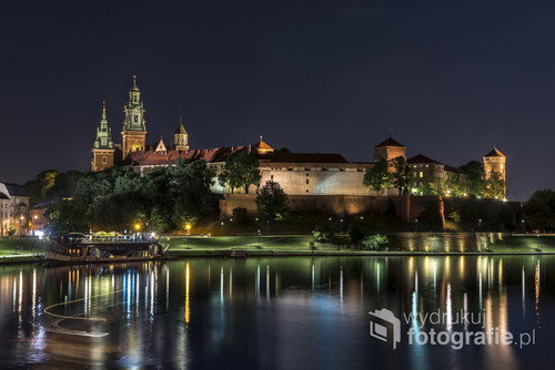 Old town of Krakow with Wawel castle illuminated at night, Krakow, Poland