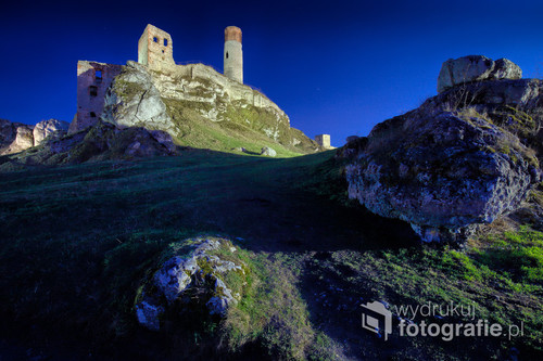 One of the Jurassic castles in Poland. A beautiful castle on limestone rocks photographed after sunset.