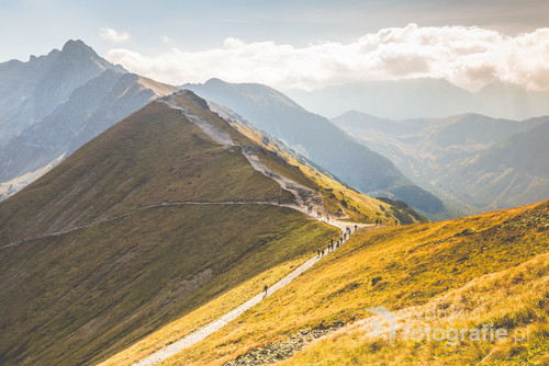Path on the steep side of Kasprowy Wierch in Tatra mountains and a view of the border between Poland and Slovakia.