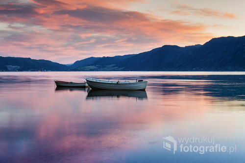 Two lonely boats on calm water of fjord. Norway.