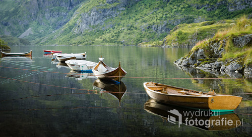 Boats moored on calm water.