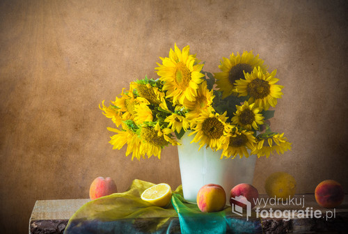 Still life with a bouquet of sunflowers and apricot fruits